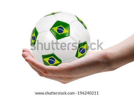 football soccer ball with nations teams flags at hand - stock photo