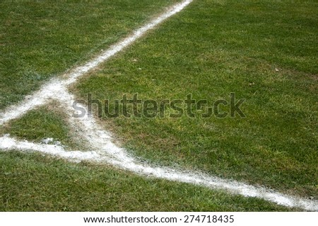 Football (soccer) field corner with white marks.