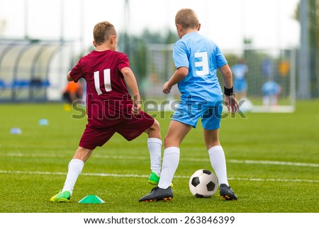 Football soccer game. Running players footballers boys playing soccer match  - stock photo