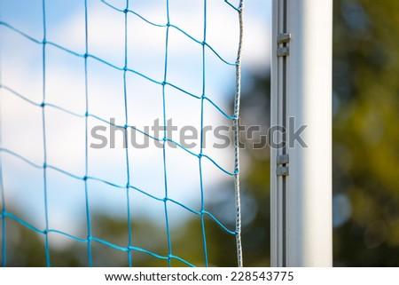 Football soccer goal net on summer background - stock photo