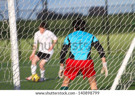 Football(soccer) goalkeeper protecting the net, shallow focus - stock photo