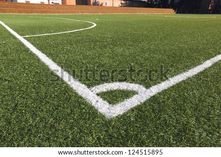 Football-Soccer green grass field, detail of the corner
