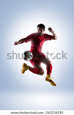 football soccer player in action  isolated on color background - stock photo