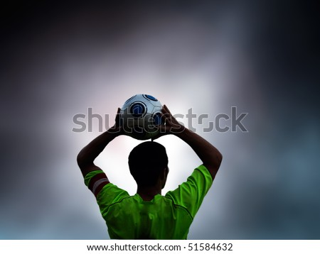 Football, soccer player throws in the ball - stock photo