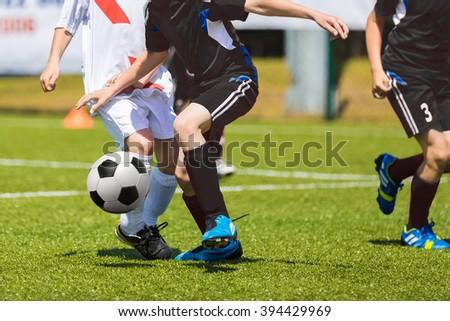 Football soccer players kicking soccer ball at the football match - stock photo