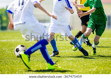 Football soccer tournament for youth teams. Soccer football training camp for kids, children. Young boys playing football soccer match. - stock photo