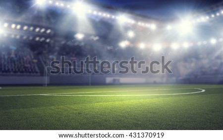 Football stadium in lights - stock photo