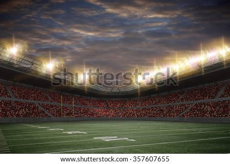 Football Stadium with fans wearing red uniforms - stock photo