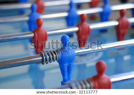 football table with blue and red figures - stock photo
