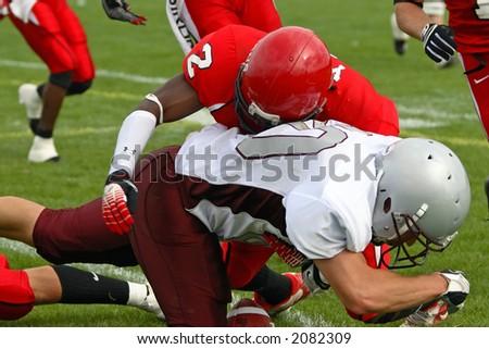 Football tackle. - stock photo