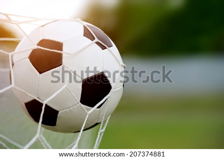 Football. The ball flies into the net gate - stock photo