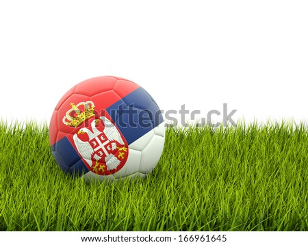 Football with flag of serbia on green grass - stock photo