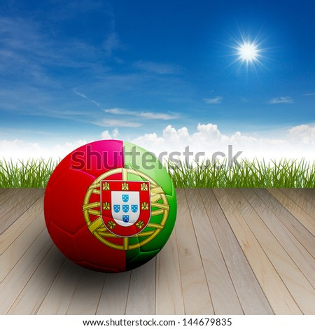 Football with flag on the wood floor with nature background.