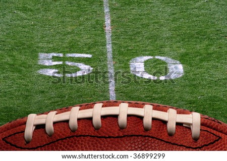 Football 50 yard line. - stock photo