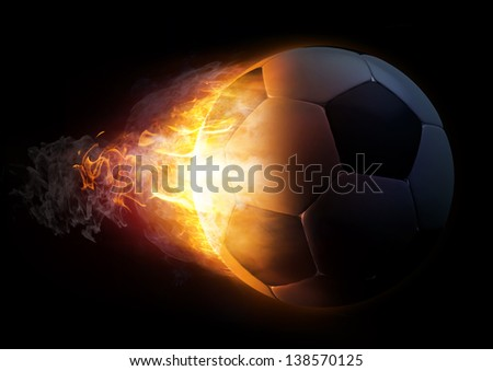 Footballl in Fire on black background - stock photo