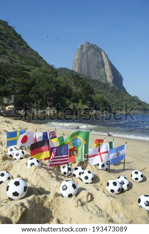 Footballs and international flags on Praia Vermelha Red Beach at Sugarloaf Mountain Rio de Janeiro Brazil - stock photo