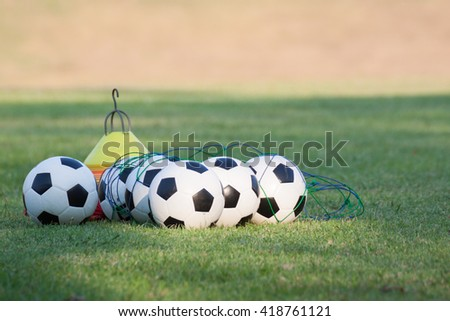 Footballs for training on a grass lawn of sport club - stock photo