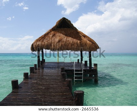 Footbridge and refuge in a caribbean lagoon - stock photo