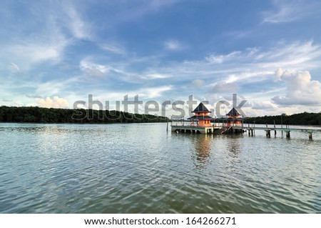 footbridge connecting with the thatched jetty in kuantan - stock photo