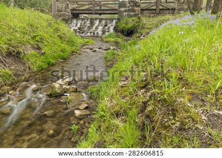 Footbridge & Dam Spring Scenic - stock photo
