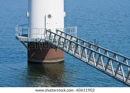 Footbridge for maintenance of a windmill standing in the sea;  the Netherlands - stock photo