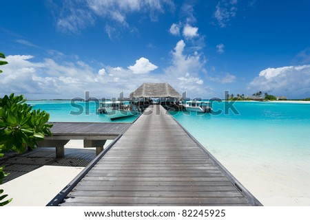 footbridge leading to the jetty on maldives island resort - stock photo