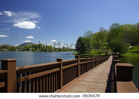 Footbridge over Lake - stock photo