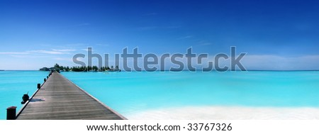 Footbridge to a tropical island - stock photo