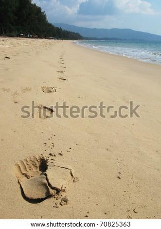 Footmarks on the sand of Bang Tao beach of Phuket island - stock photo