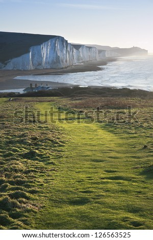 Footpath along Seaford Head towards Seven Sisters cliffs - stock photo