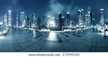 footpath and modern buildings at night - stock photo