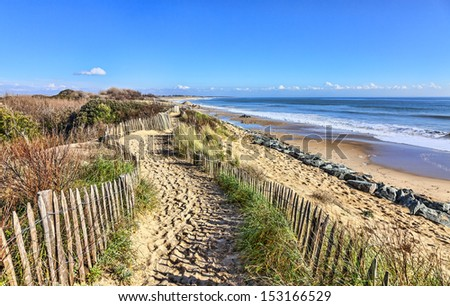 Footpath between wooden fences on the Atlantic Dune in Brittany, in north-west of France. - stock photo