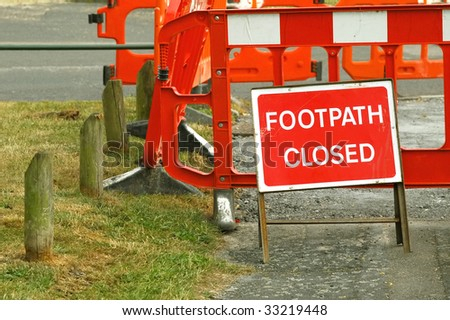footpath closed by road maintenance  barrier sign - stock photo