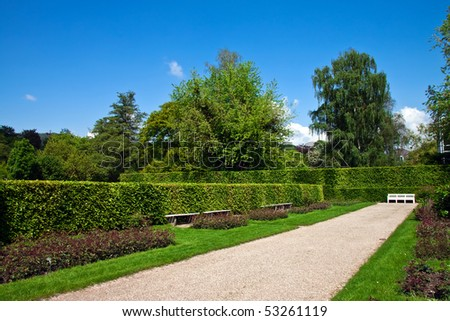 Footpath in a beautiful park. Landscape. - stock photo