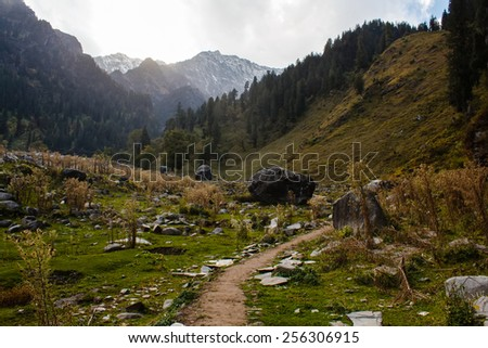 footpath in himalayan mountains in india in sunset light - stock photo