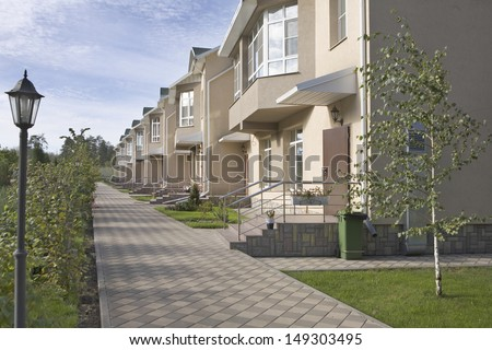 Footpath in new housing development - stock photo