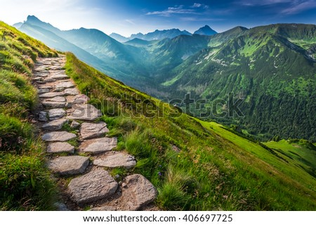 Footpath in the Tatras Mountains at sunrise, Poland - stock photo