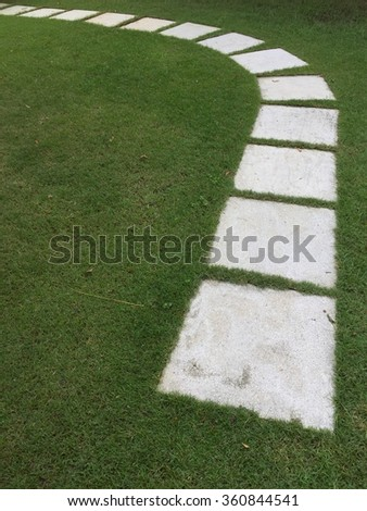 Footpath on th green grass - stock photo