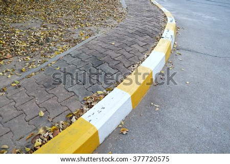 footpath pavement sidewalk with traffic sign - stock photo