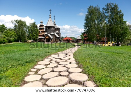 Footpath to old Russian wooden churches in Suzdal. Two churches of the 18th century - the Church of the Transfiguration and the Church of the Resurrection in Suzdal. - stock photo