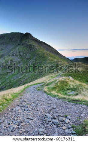Footpath towards Deepdale Hause and Cofa Pike in the English Lake District - stock photo