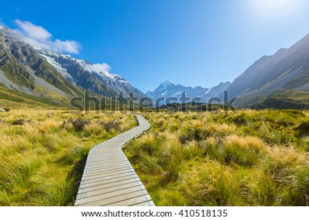Footpath trail section in Hooker Valley on a track leading to Aoraki, Mount Cook, highest peak of Southern Alps, New Zealand - stock photo