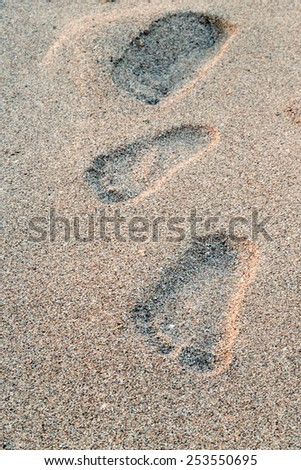 footprint in the sand beach - stock photo