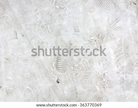 Footprint in the snow. - stock photo