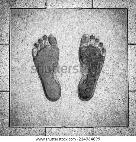 Footprint monument - stock photo