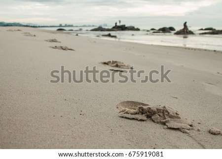 footprint on the beach at a morning