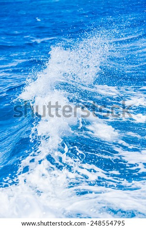 footprint on the sea water from the ship sailing - stock photo