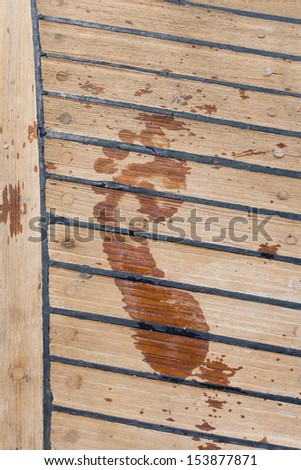 footprint on the wooden deck sailing ship - stock photo