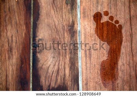 Footprint on Wood - stock photo