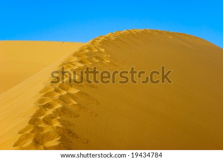 Footprint path on Sand Dune - stock photo